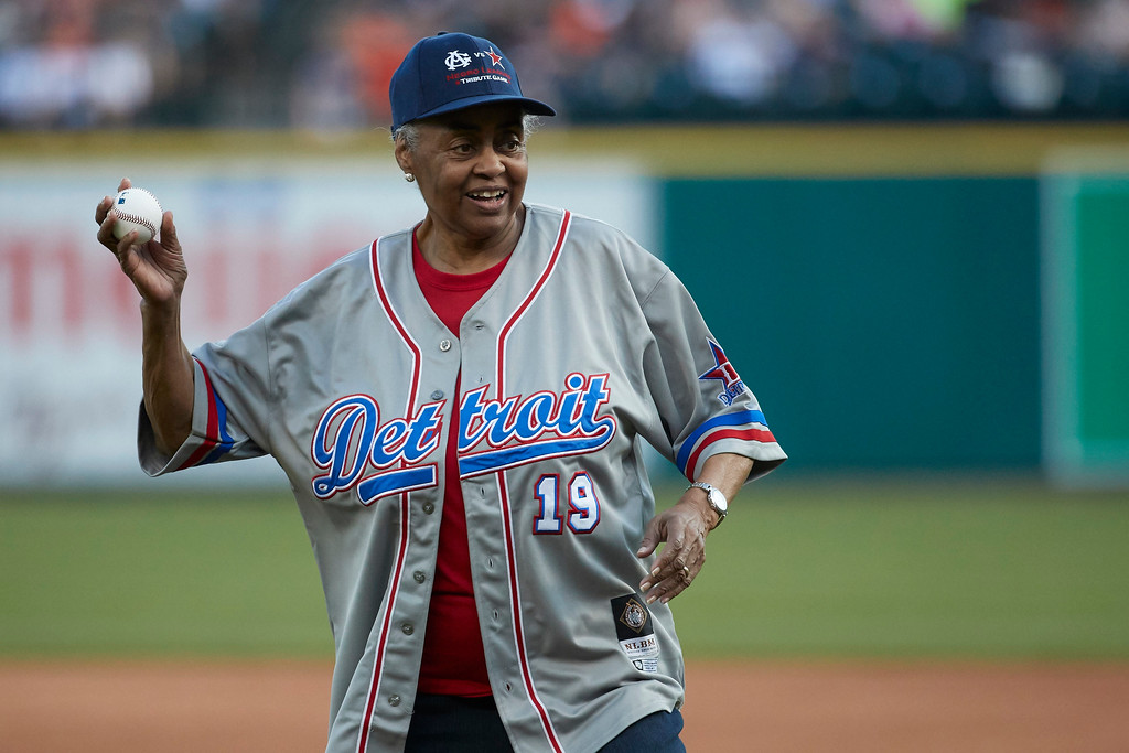 . Former Negro League player and team owner Minnie Forbes throws out a ceremonial first pitch prior to the second baseball game of a doubleheader between the Detroit Tigers and the Cleveland Indians in Detroit, Saturday, July 1, 2017. (AP Photo/Rick Osentoski)