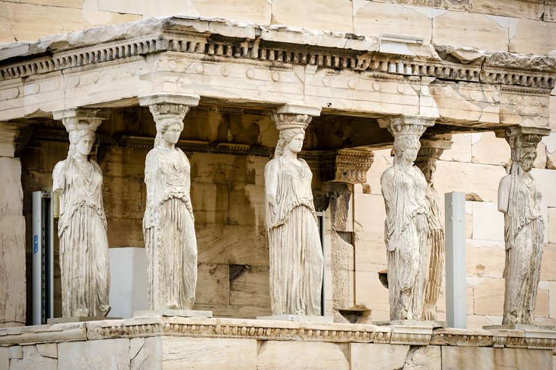 Females statues holding up temple at the Acropolis, Athens, Greece
