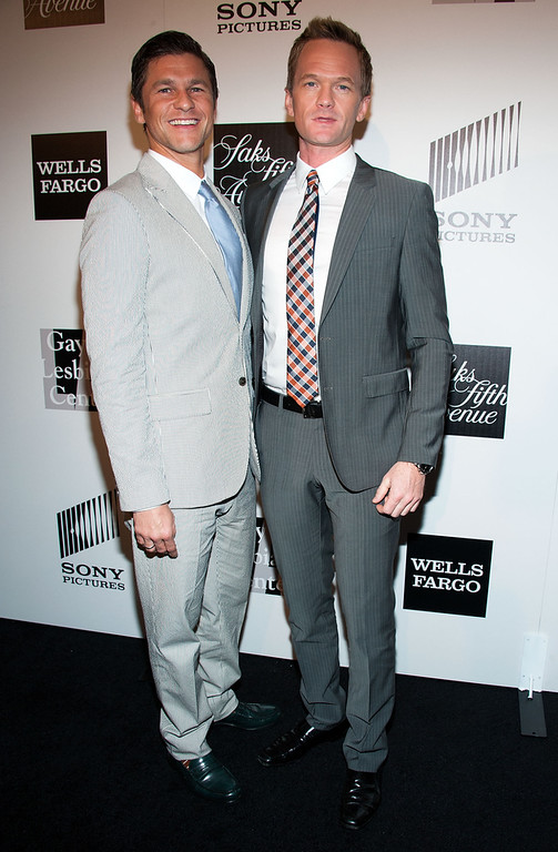 ". David Burtka and Neil Patrick Harris (R) arrives at ""An Evening\"" Benefiting The L.A. Gay & Lesbian Center at the Beverly Wilshire Four Seasons Hotel on March 21, 2013 in Beverly Hills, California. (Photo by Valerie Macon/Getty Images)"