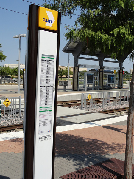 Bus loading zone - pedestrian crossing and information post. taken from the door of the 'A-TRAIN' looking across the Dallas Light-Rail at the bus loading zone.