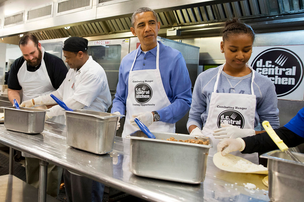 . President Barack Obama and his daughter Sasha, right, make burritos at DC Central Kitchen as part of a service project in honor of Martin Luther King, Jr. Day,  Monday, Jan. 20, 2014, in Washington. Also helping were first lady Michelle Obama and daughter Malia Obama. (AP Photo/Jacquelyn Martin)