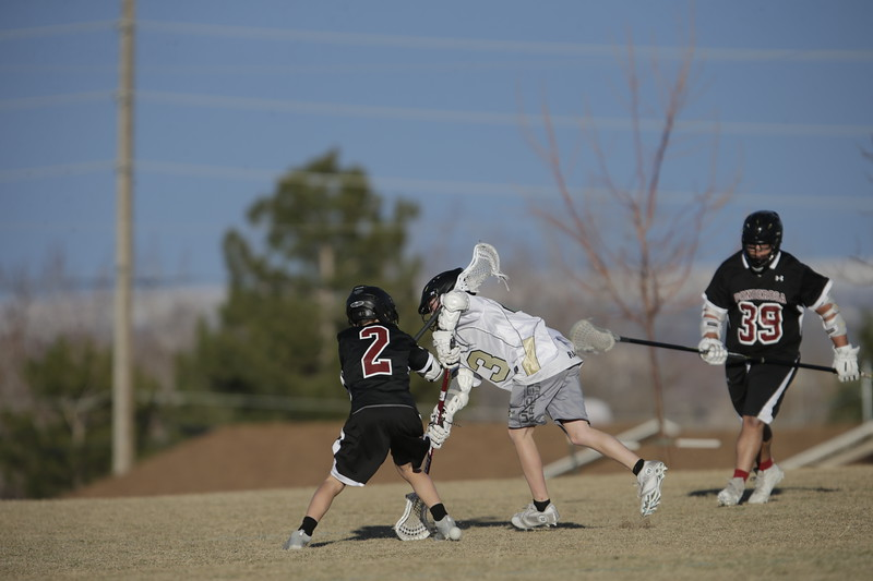JPM0485-JPM0485-Jonathan first HS lacrosse game March 9th.jpg