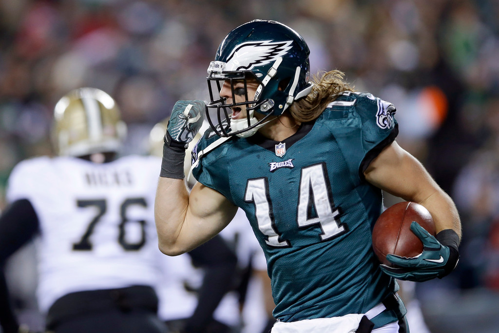 . Philadelphia Eagles\' Riley Cooper celebrates after scoring a touchdown during the first half of an NFL wild-card playoff football game against the New Orleans Saints, Saturday, Jan. 4, 2014, in Philadelphia. (AP Photo/Michael Perez)