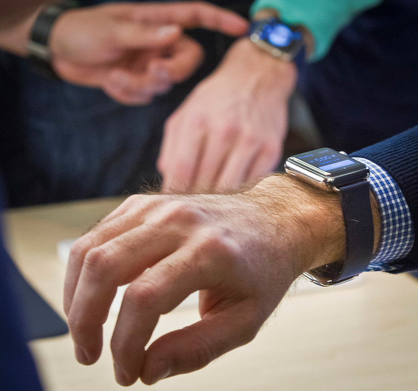 . Customers wear demo versions of Apple\'s new watch, which could only be bought pre-order online, Friday, April 10, 2015, in New York. The first new gadget under CEO Tim Cook is selling in eight countries and Hong Kong, with shipments scheduled to start April 24.  (AP Photo/Bebeto Matthews)