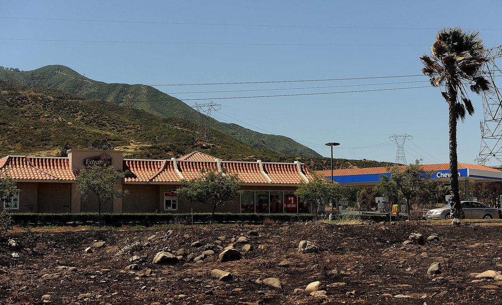 . A view of a strip mall that burned in Mondays fire along the I-15 freeway near Sierra Avenue exit in North Fontana May 14, 2013.  GABRIEL LUIS ACOSTA/STAFF PHOTOGRAPHER.