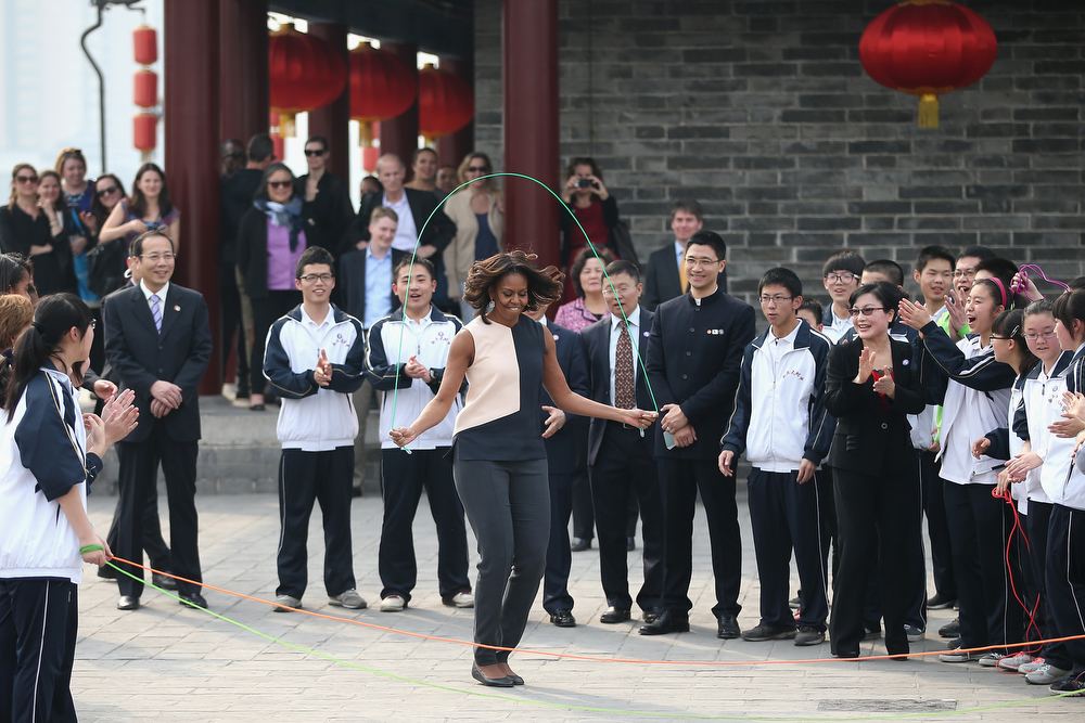 . First Lady Michelle Obama (Center) with her daughters Malia Obama and Sasha Obama, mother Marian Robinson visit the Xi\'an City Wall on March 24, 2014 in Xi\'an, China. Michelle Obama\'s one-week-long visit in China will be focused on educational and cultural exchanges.  Michelle Obama\'s one-week-long visit in China will be focused on educational and cultural exchanges.  (Photo by Feng Li/Getty Images)