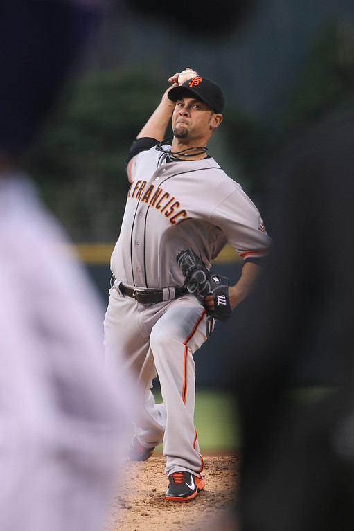 . San Francisco Giants starting pitcher Ryan Vogelsong works against the Colorado Rockies in the first inning of a baseball game in Denver on Monday, April 21, 2014. (AP Photo/David Zalubowski)