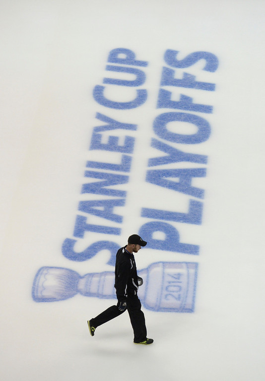 . DENVER, CO - APRIL 24: A Pepsi Center employee walked across the ice before the game Saturday. The Colorado Avalanche hosted the Minnesota Wild in the fifth game of a playoff series Saturday night, April 26, 2014. (Photo by Karl Gehring/The Denver Post)