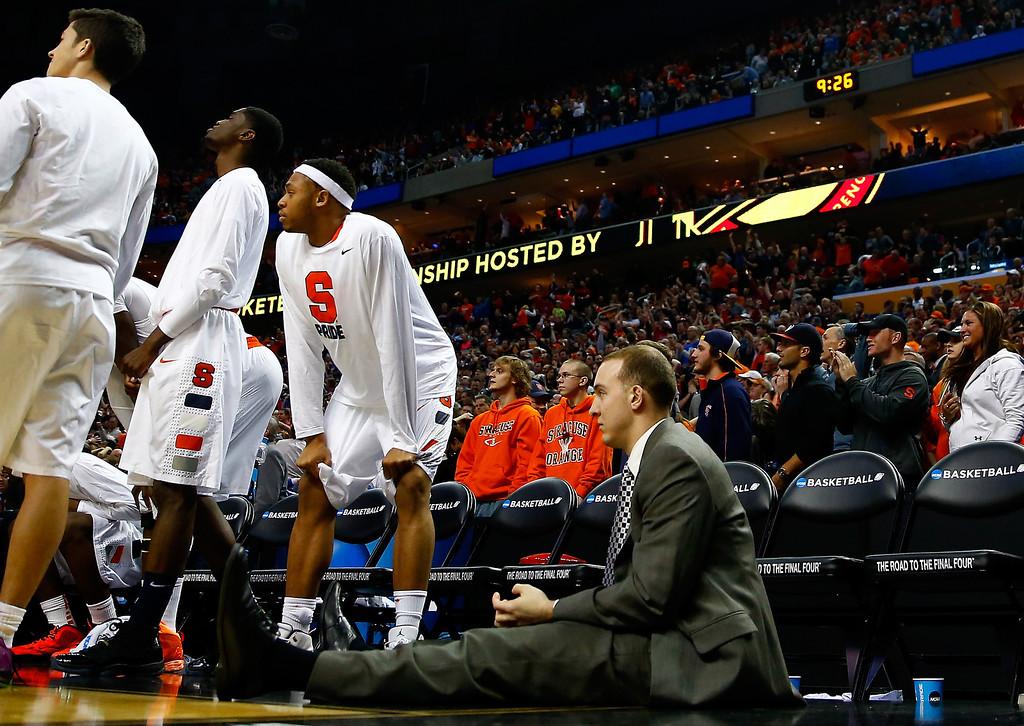 . BUFFALO, NY - MARCH 22:  The Syracuse Orange bench looks after losing in the third round of the 2014 NCAA Men\'s Basketball Tournament against the Dayton Flyers at the First Niagara Center on March 22, 2014 in Buffalo, New York. The Dayton Flyers defeated the Syracuse Orange 55-53.  (Photo by Jared Wickerham/Getty Images)