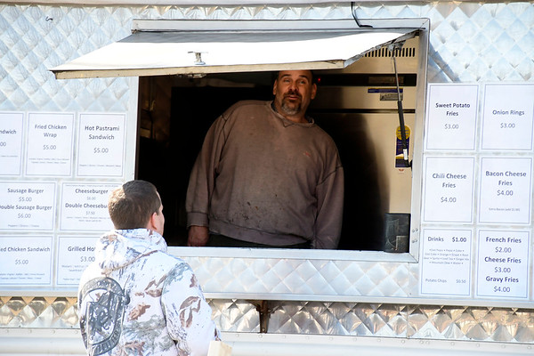 3/18/2020 Mike Orazzi | Staff Steve Lavoie, operator of the Top Dog food truck on Middle Street has made changes to how he servers customers because of the Coronavirus.