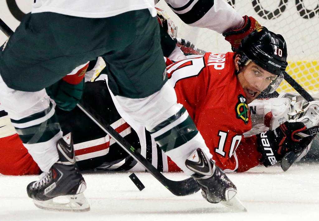 . Chicago Blackhawks\' Patrick Sharp (10) watches the puck after missing a goal during the second period. (AP Photo/Nam Y. Huh)