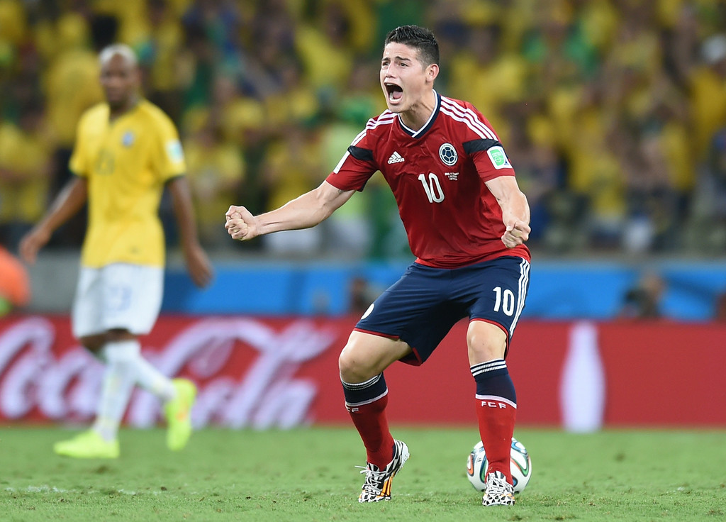 . Colombia\'s midfielder James Rodriguez celebrates scoring a penlaty during the quarter-final football match between Brazil and Colombia at the Castelao Stadium in Fortaleza during the 2014 FIFA World Cup on July 4, 2014. VANDERLEI ALMEIDA/AFP/Getty Images