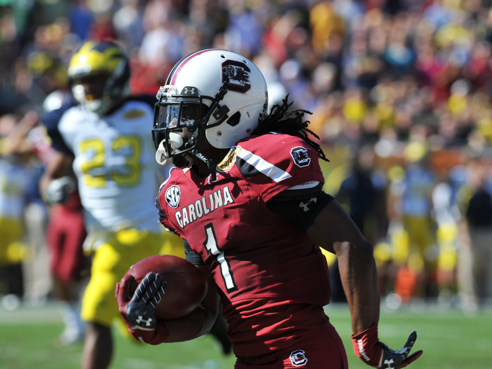 . Wide receiver Ace Sanders #1 of the South Carolina Gamecocks returns a punt 54 yards for a first quarter touchdown against the Michigan Wolverines in the Outback Bowl January 1, 2013 at Raymond James Stadium in Tampa, Florida.  (Photo by Al Messerschmidt/Getty Images)