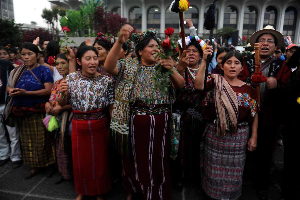 . Ixil women, including Guatemala\'s civil war survivor Maria Raymundo (C), celebrate after listening the sentence given to former Guatemalan de facto President (1982-1983), retired General Jose Efrain Rios Montt, 86, for crimes committed during his regime, in Guatemala City, on May 10, 2013. Rios Montt was found guilty of genocide and war crimes on Friday in a landmark ruling stemming from massacres of indigenous people in his country\'s long civil war. Rios Montt thus became the first Latin American convicted of trying to exterminate an entire group of people in a brief but particularly gruesome stretch of a war that started in 1960, lasted 36 years and left around 200,000 people dead or missing.  JOHAN ORDONEZ/AFP/Getty Images