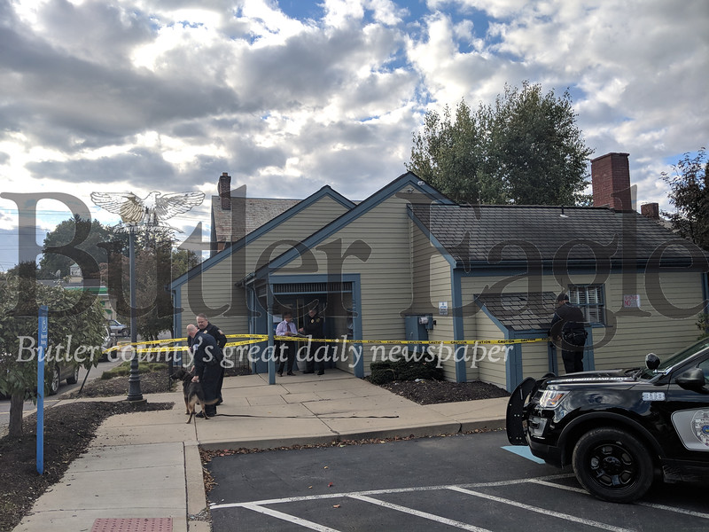 Police are working with a k9 unit around the area of the robbery at the NexTier Bank in Zelienople Tuesday, Oct. 23, 2018. Caleb Harshberger/Butler Eagle