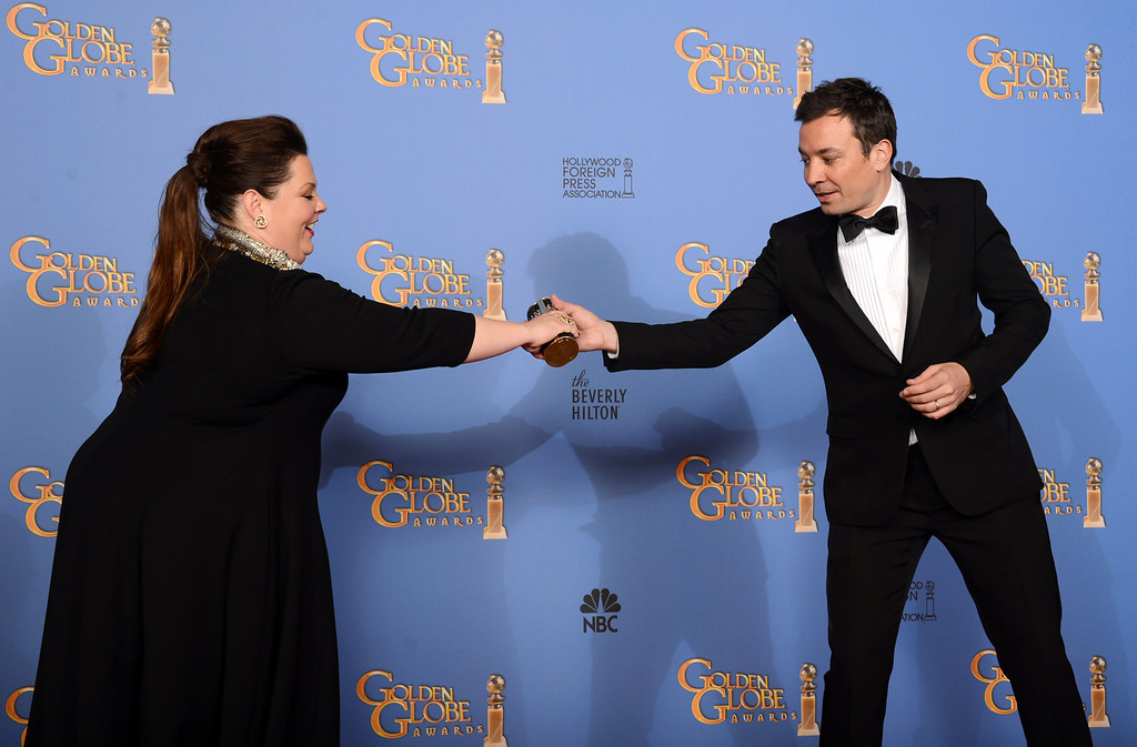 . Melissa McCarthy, left, and Jimmy Fallon pose in the press room at the 71st annual Golden Globe Awards at the Beverly Hilton Hotel on Sunday, Jan. 12, 2014, in Beverly Hills, Calif. (Photo by Jordan Strauss/Invision/AP)