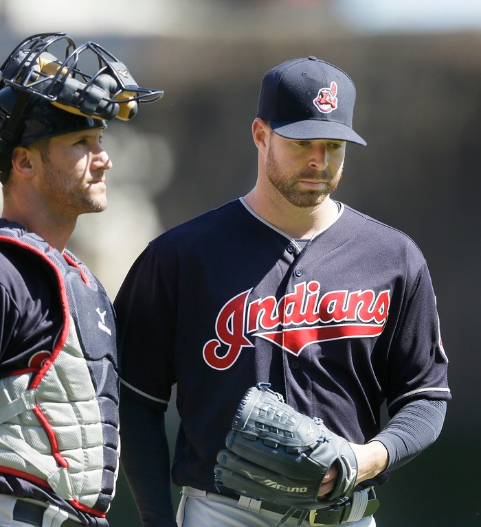 . Cleveland Indians starting pitcher Corey Kluber is congratulated by catcher Yan Gomes after the seventh inning of a baseball game against the Detroit Tigers, Saturday, April 23, 2016, in Detroit. Kluber struck out 10 over eight innings and the Indians routed the Tigers 10-1 for Kluber\'s first win of the season. (AP Photo/Carlos Osorio)