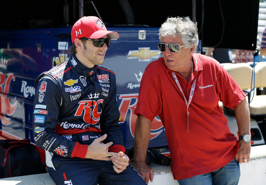 . Marco Andretti, left, talk with his grandfather and 1969 Indy 500 champion Mario Andretti during practice for the Indianapolis 500 auto race at the Indianapolis Motor Speedway in Indianapolis, Wednesday, May 15, 2013. (AP Photo/Darron Cummings)