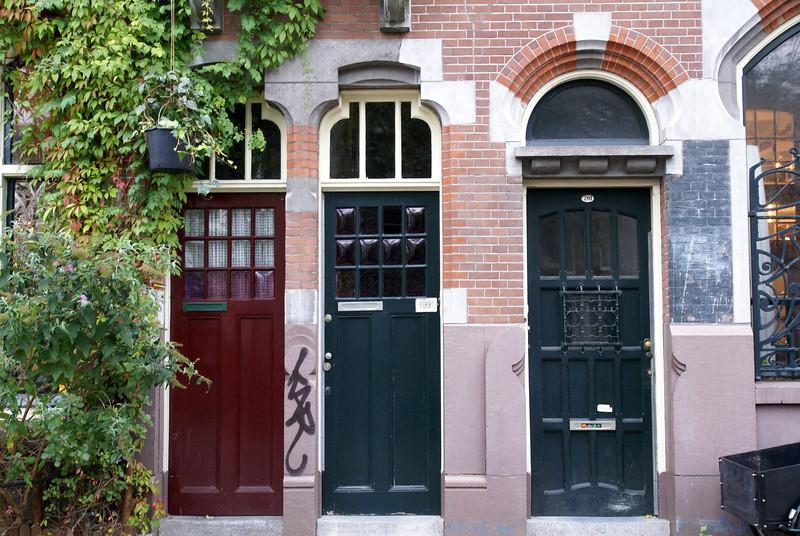 Doors along a canal street.