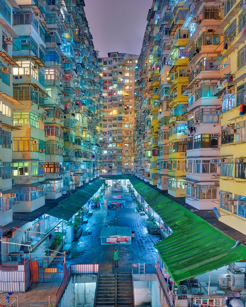Hey, when it comes to government housing, it's hard to get more interesting than this! We had a long day running all around Hong Kong and exploring with my new friend Simon. He was a great local resource to show me some of his favorite spots. I think this was my final shot for the evening before we decided to go off bar hopping together! And for you Passport Members I hope you enjoyed the post-processing on this one.  - Trey Ratcliff  Click here to read the rest of this post at the Stuck in Customs blog.