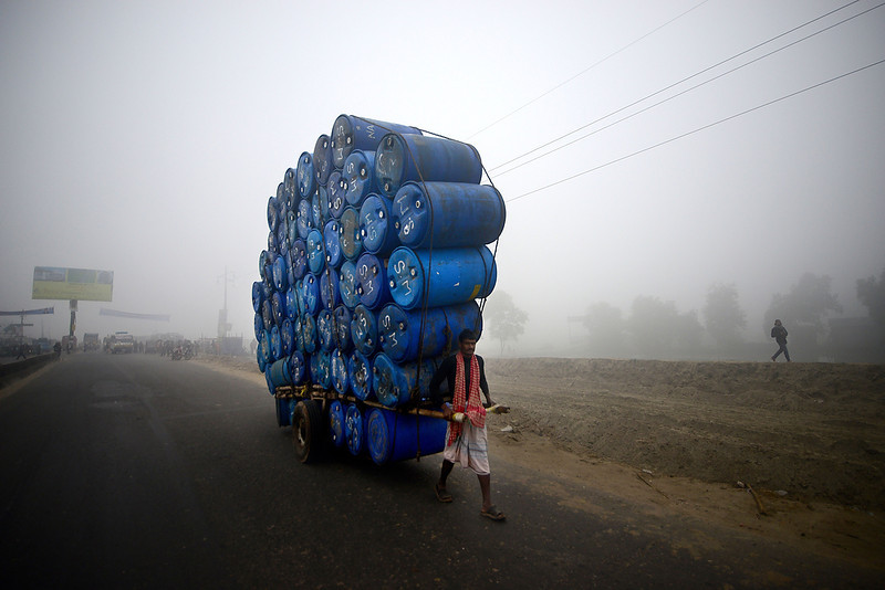 . A Bangladeshi laborer pulls a cart full of empty drums during a nationwide strike in Dhaka on December 20, 2012. Twelve Islamic parties called an eight-hour general strike in the capital Dhaka and a dawn-to-dusk general strike across the country as they seek a ban on left-wing political parties.  MUNIR UZ ZAMAN/AFP/Getty Images