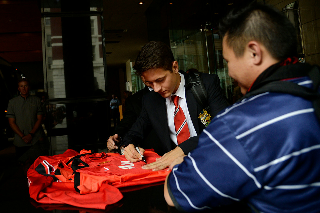 . DENVER, CO - JULY 24: Manchester United\'s off season acquisition Andrea Herrera signs a jersey for fans as he and fellow squad members arrive at their hotel. Manchester United will play Italian squad Roma on Saturday, July 26 and arrived in Denver on Thursday, July 24, 2014. (Photo by AAron Ontiveroz/The Denver Post)