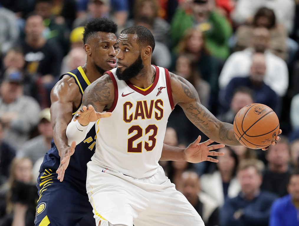 . Cleveland Cavaliers\' LeBron James is defended by Indiana Pacers\' Thaddeus Young during the second half of an NBA basketball game, Friday, Dec. 8, 2017, in Indianapolis. The Pacers won 106-102. (AP Photo/Darron Cummings)