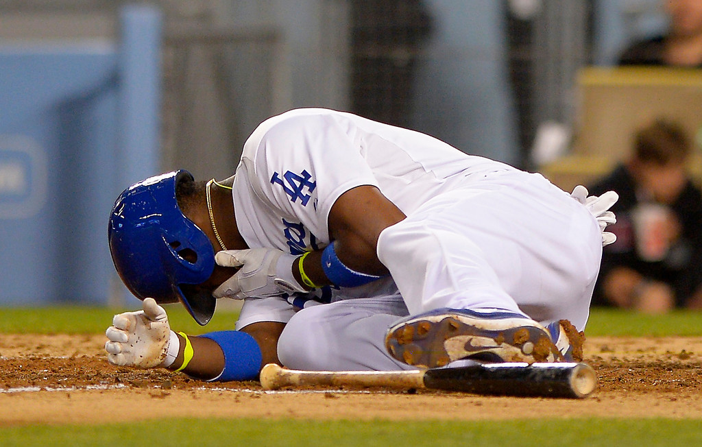 . Los Angeles Dodgers\' Yasiel Puig after being hit by a pitch during the sixth inning of their baseball game against the Arizona Diamondbacks, Tuesday, June 11, 2013, in Los Angeles.  (AP Photo/Mark J. Terrill)