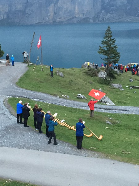 Alpine horns playing at Oeschinensee