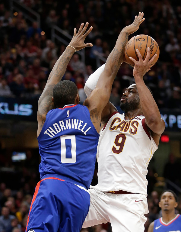 . Cleveland Cavaliers\' Dwyane Wade (9) drives to the basket against Los Angeles Clippers\' Sindarius Thornwell (0) during the first half of an NBA basketball game, Friday, Nov. 17, 2017, in Cleveland. (AP Photo/Tony Dejak)