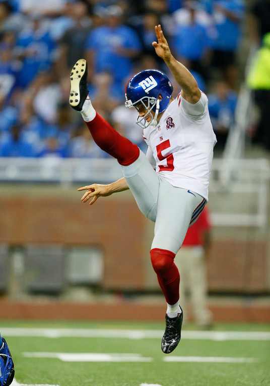 . New York Giants punter Steve Weatherford (5) kicks during the first quarter of an NFL football game against the in Detroit, Monday, Sept. 8, 2014. (AP Photo/Rick Osentoski)