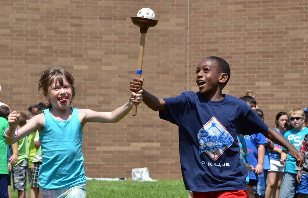 . Second graders Taylor Orndorff, left, and Mark Cobbs compete  in the torch relay during Olympics Day at Hatfield Elementary School.   Friday,  June 6, 2014.   Photo by Geoff Patton