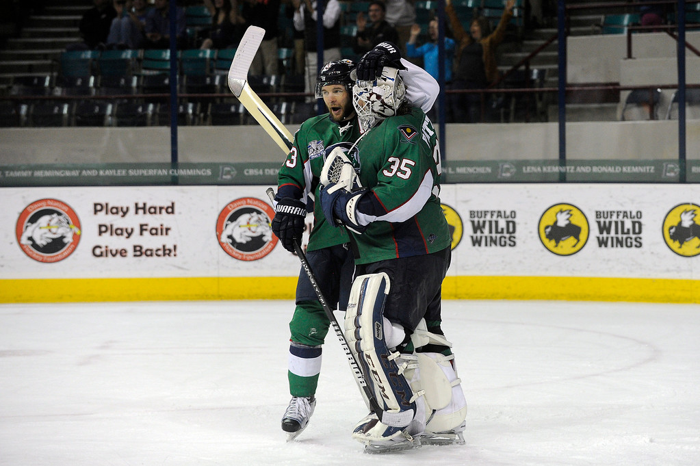 . DENVER, CO - MAY 2: TJ Fox (13) of the Denver Cutthroats congratulates Denver Cutthroats goalie Kent Patterson (35) as time expires on the third period of game 1 of the Ray Miron Presidents Cup Finals at the Denver Coliseum in Denver, Colorado on May 2, 2014. (Photo by Seth McConnell/The Denver Post)