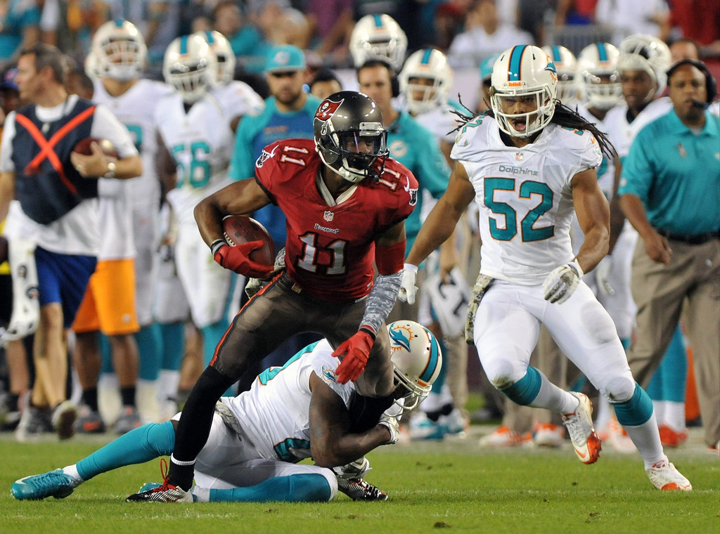 . Wide receiver Tiquan Underwood #11 of the Tampa Bay Buccaneers grabs a 1st quarter pass at midfield during the opening drive against the Miami Dolphins November 11, 2013 at Raymond James Stadium in Tampa, Florida. (Photo by Al Messerschmidt/Getty Images)