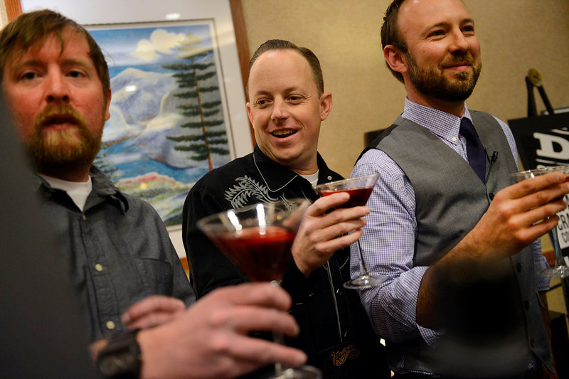 . (l-r) Rob Masters, President of the Colorado Distillers Guild, Chris Koons, of Peach Street Distillers, and Brian Melton, of the Colorado Bartenders Guild, join in a toast during the American Distilling Institute\'s 10th Annual Craft Spirits Conference & Vendors Expo at the downtown Sheraton in Denver, CO April 02, 2013. DSTILL  expects more than 900 visitors during the weeklong celebration, making it the country�s largest rally of independent distillers.  (Photo By Craig F. Walker/The Denver Post)