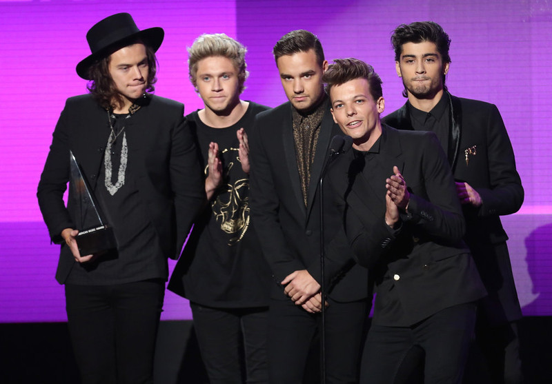 . Harry Styles, from left, Niall Horan, Liam Payne, Louis Tomlinson and Zayn Malik of the musical group One Direction accept the award for pop/rock band, duo or group on stage at the 42nd annual American Music Awards at Nokia Theatre L.A. Live on Sunday, Nov. 23, 2014, in Los Angeles. (Photo by Matt Sayles/Invision/AP)
