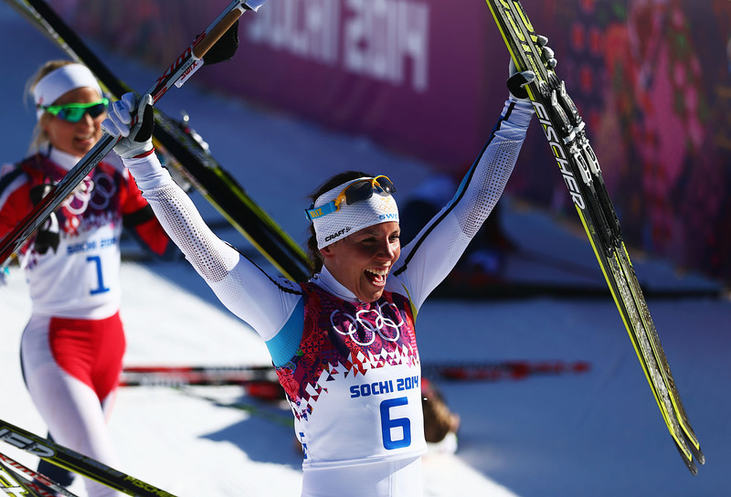 . Silver medalist Charlotte Kalla of Sweden celebrates after the Ladies\' Skiathlon 7.5 km Classic + 7.5 km Free during day one of the Sochi 2014 Winter Olympics at Laura Cross-country Ski & Biathlon Center on February 8, 2014 in Sochi, Russia.  (Photo by Clive Mason/Getty Images)