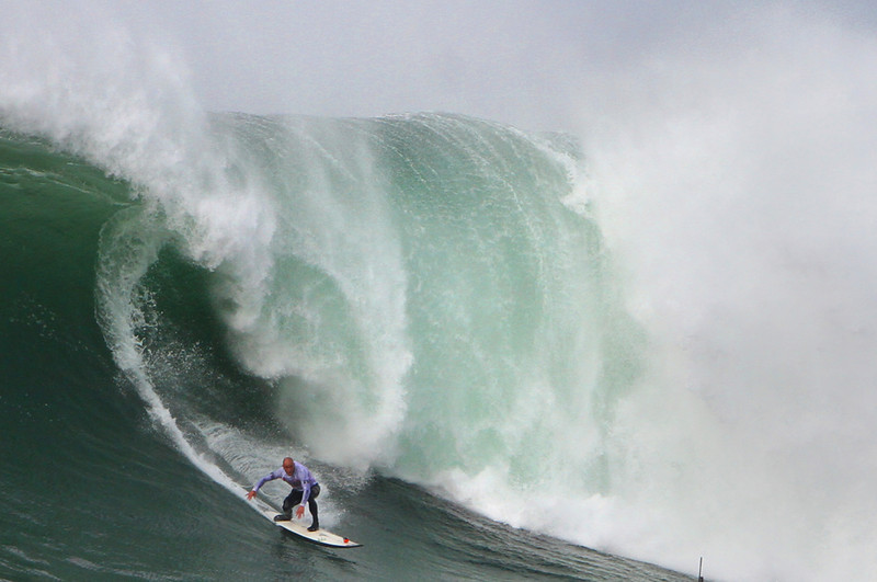 . Shane Dorian completes his run on a towering wave during the Mavericks Invitational semifinals at Half Moon Bay on Friday afternoon. Dorian finished second overall in the event. (Kevin Johnson/Sentinel)