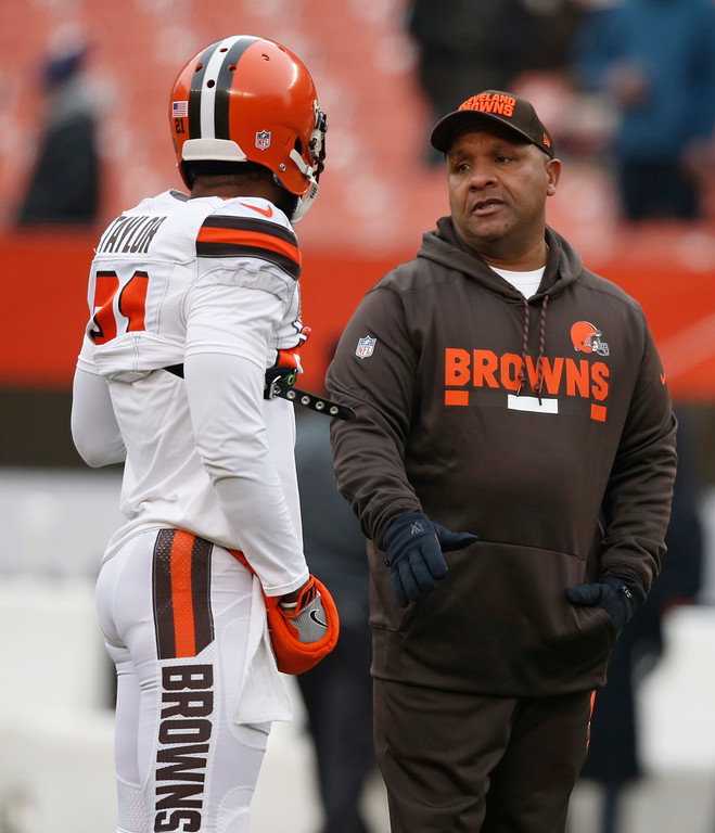 . Cleveland Browns head coach Hue Jackson, right, talks with cornerback Jamar Taylor before an NFL football game between the Baltimore Ravens and the Cleveland Browns, Sunday, Dec. 17, 2017, in Cleveland. (AP Photo/Ron Schwane)