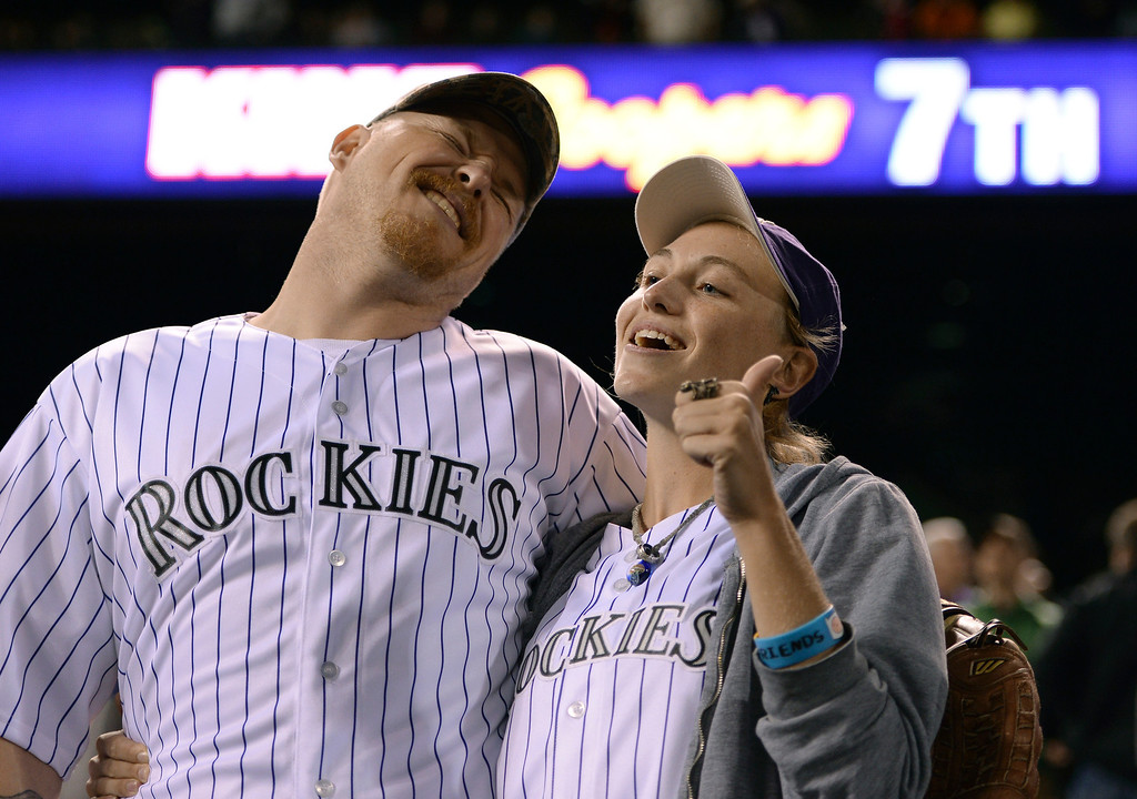 . Palmer Baldwin sang Take Me Out to The Ballgame with fiancé Emily Wilson in the 7th inning. The Colorado Rockies hosted the San Francisco Giants Wednesday night, May 21, 2014.  (Photo by Karl Gehring/The Denver Post)