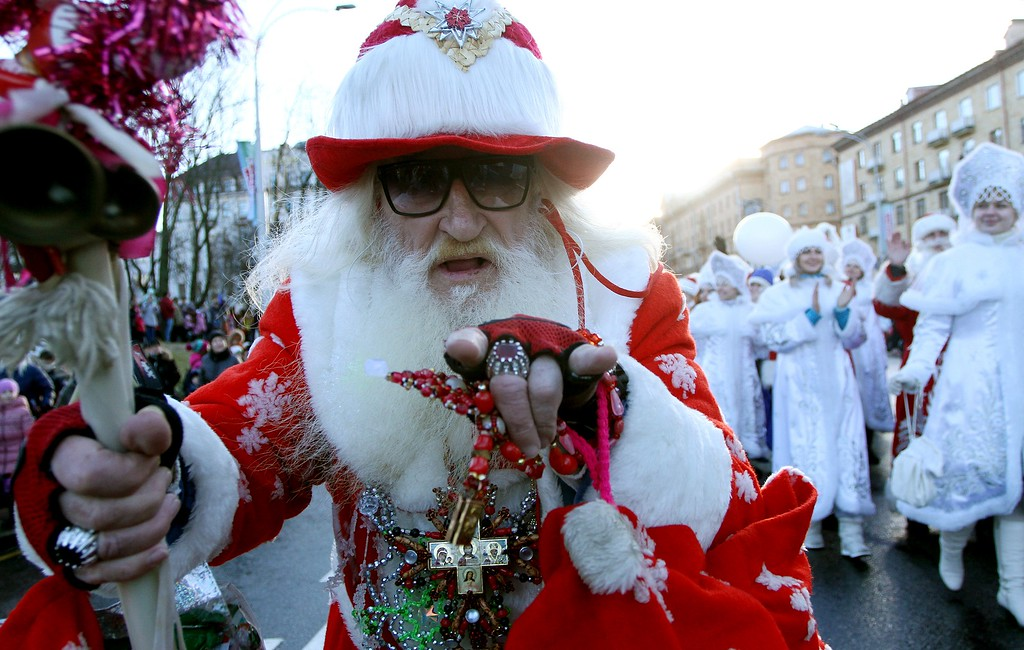 . A man dressed as Father Frost, the equivalent of Santa Claus, takes part in an annual New Year\'s parade in Minsk on December 25, 2014. SERGEI GAPON/AFP/Getty Images