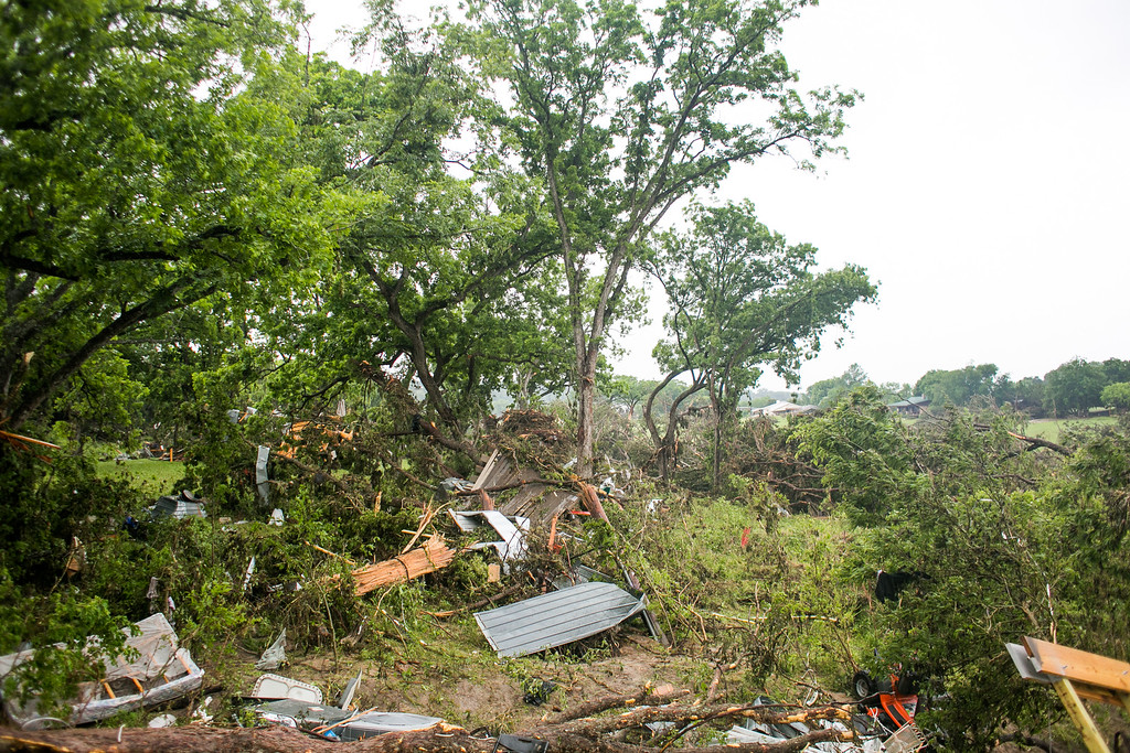 . WIMBERLEY, TX - MAY 25:   Debris is shown scattered on land next to Texas Ranch Road 12 on May 25, 2015 in Wimberly, Texas.  Texas Gov. Greg Abbott toured the damage zone where one person is confirmed dead and at least 12 others missing in flooding along the Rio Blanco, which reports say rose as much as 40 feet in places, caused by more than 10 inches of rain over a four-day period. The governor earlier declared a state of emergency in 24 Texas counties.  (Photo by Drew Anthony Smith/Getty Images)