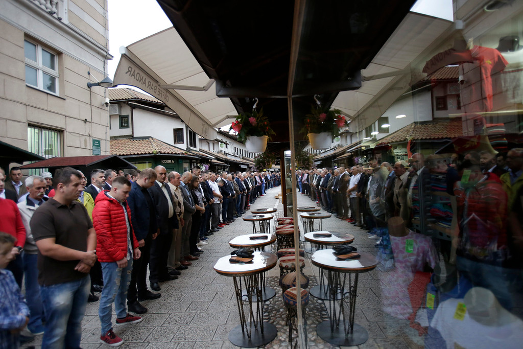 . Bosnian Muslims offer prayers during the first day of Eid al-Fitr, which marks the end of the holy fasting month of Ramadan at the street near Begova Mosque in Sarajevo, Bosnia early Friday, June 15, 2018. (AP Photo/Amel Emric)