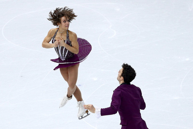 . Meagan Duhamel and Eric Radford of Canada compete in the Figure Skating Pairs Free Skating during day five of the 2014 Sochi Olympics at Iceberg Skating Palace on February 12, 2014 in Sochi, Russia.  (Photo by Clive Mason/Getty Images)