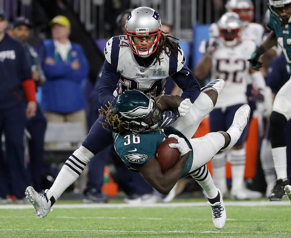 . Philadelphia Eagles\' Jay Ajayi (36) is stopped by New England Patriots\' Stephon Gilmore during the first half of the NFL Super Bowl 52 football game Sunday, Feb. 4, 2018, in Minneapolis. (AP Photo/Matt Slocum)