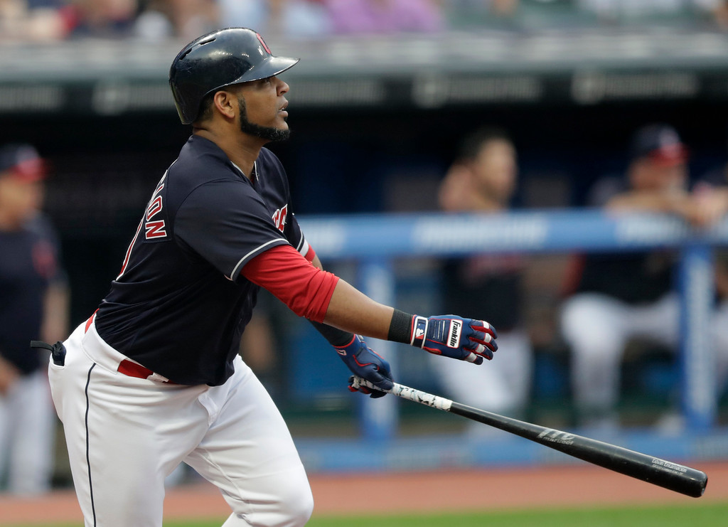 . Cleveland Indians\' Edwin Encarnacion watches his sacrifice fly off Minnesota Twins starting pitcher Jake Odorizzi during the first inning of a baseball game Wednesday, Aug. 8, 2018, in Cleveland. Francisco Lindor scored on the play. (AP Photo/Tony Dejak)