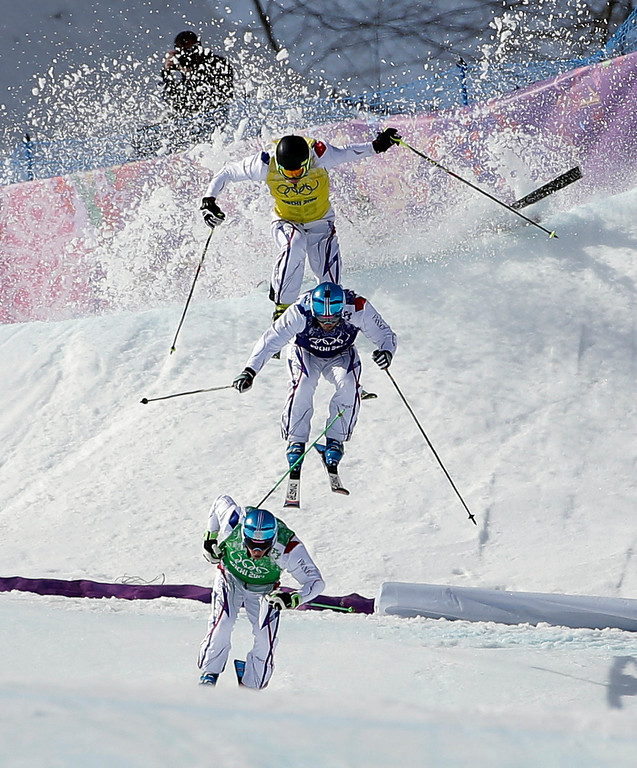 . Jean Frederic Chapuis of France, bottom, leads compatriots Arnaud Bovolenta, and Jonathan Midol, as Canada\'s Brady Leman crashes behind them in the men\'s ski cross final at the Rosa Khutor Extreme Park, at the 2014 Winter Olympics, Thursday, Feb. 20, 2014, in Krasnaya Polyana, Russia. (AP Photo/Andy Wong)