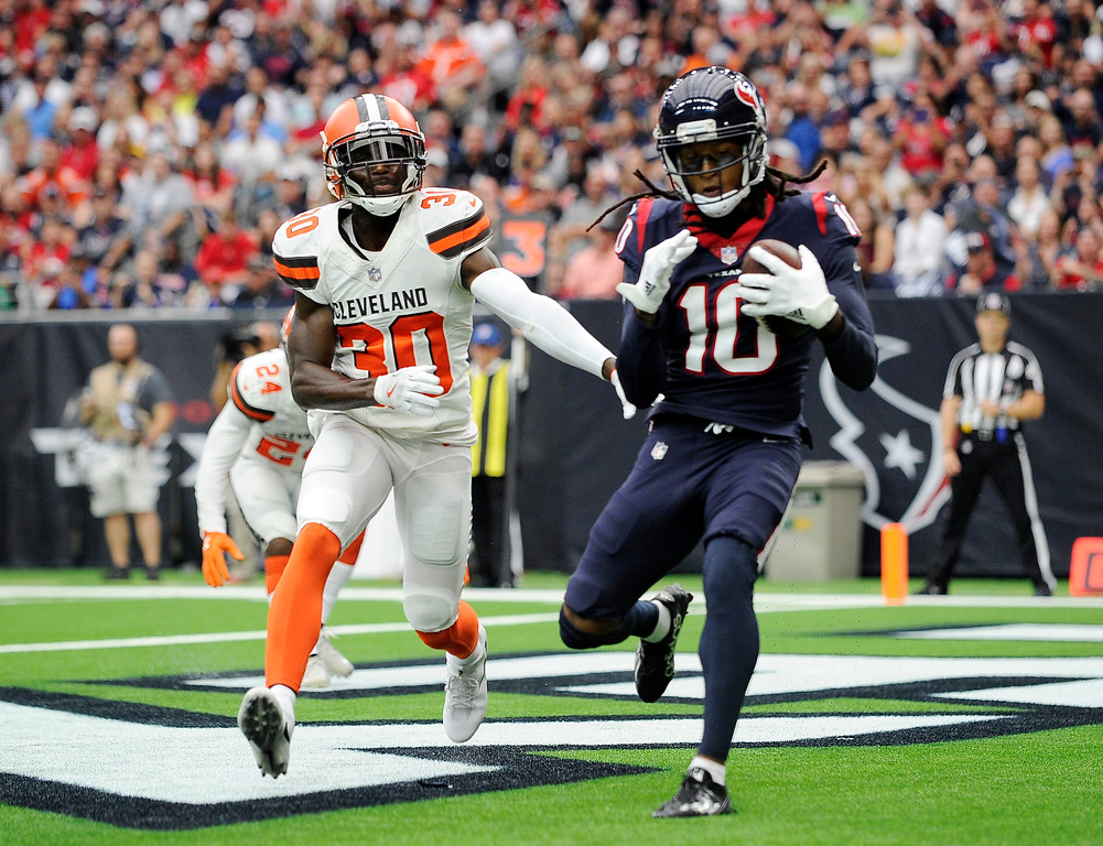 . Cleveland Browns cornerback Jason McCourty (30) is unable to stop Houston Texans wide receiver DeAndre Hopkins (10) from catching a touchdown pass in the second half of an NFL football game, Saturday, Oct. 14, 2017, in Houston. (AP Photo/Eric Christian Smith)