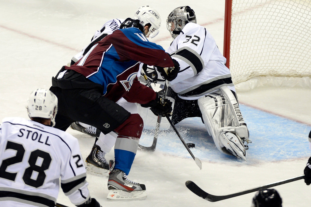 . DENVER, CO. - JANUARY 22: Los Angeles Kings goalie Jonathan Quick (32) blocks a shot by Colorado Avalanche left wing Jamie McGinn (11) during a five-on-three power play for Colorado in the second period. The Colorado Avalanche hosted the Los Angeles Kings at the Pepsi Center on January, 22, 2013.   (Photo By John Leyba / The Denver Post)