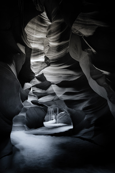 Sand cascades down sandstone inside Antelope Canyon.